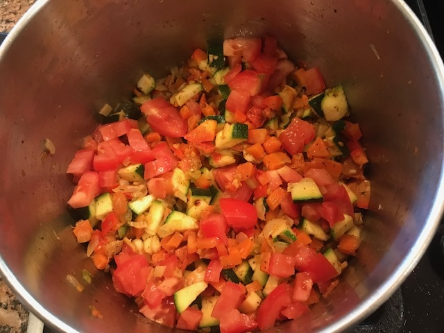 bell pepper, tomato and zucchini added to the sautéed onion herb mixture