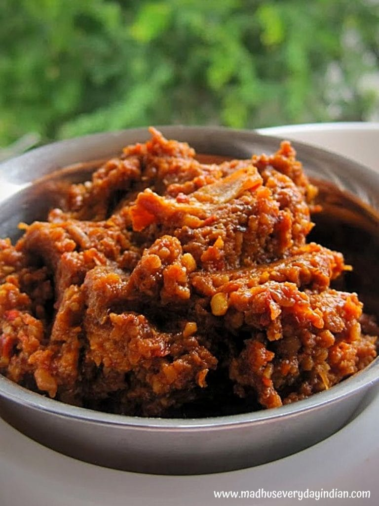 minapa pappu pachadi served in a steel bowl