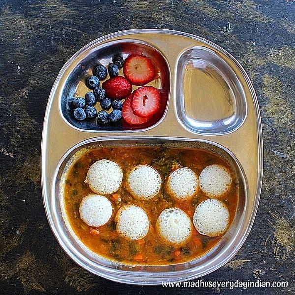 mini idli served with sambar and berries