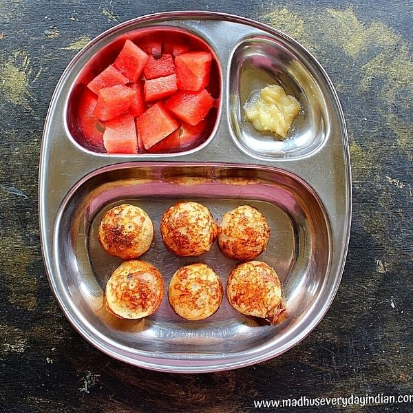 6 paniyaram served with ghee and water melon