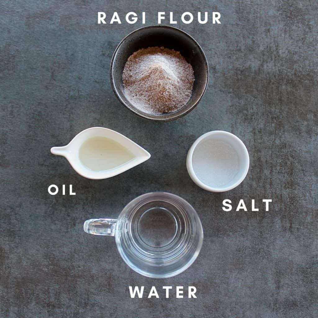 picture of the ingredients needed to make ragi roti- ragi flour, oil, salt and water.