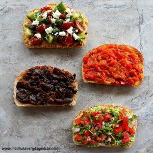 4 savory toast arranged on a board