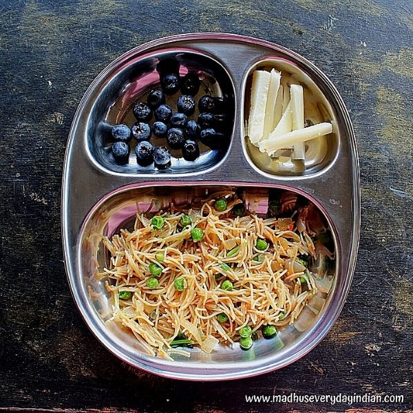 vermicelli upma served with blue berries and mozzarella cheese