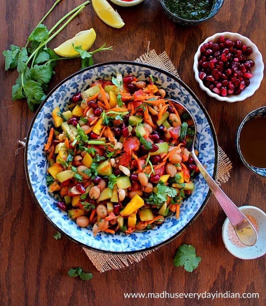 peanut chaat served in a colorful bowl, with pomegranate and other chutneys.