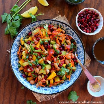 boiled peanut chaat served in a colorful bowl, with pomegranate and other chutneys.