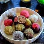 almond chocolate truffles arranged in a white plate