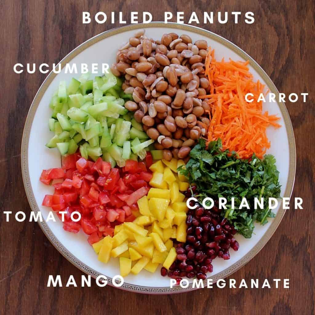 ingredients needed to make peanut chaat are arranged in a large white plate