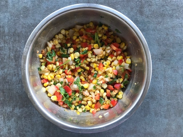 corn salad tossed with spices.