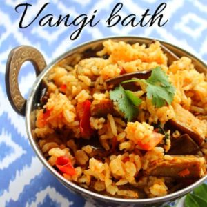 vangi bath served in a steel kadai garnished with