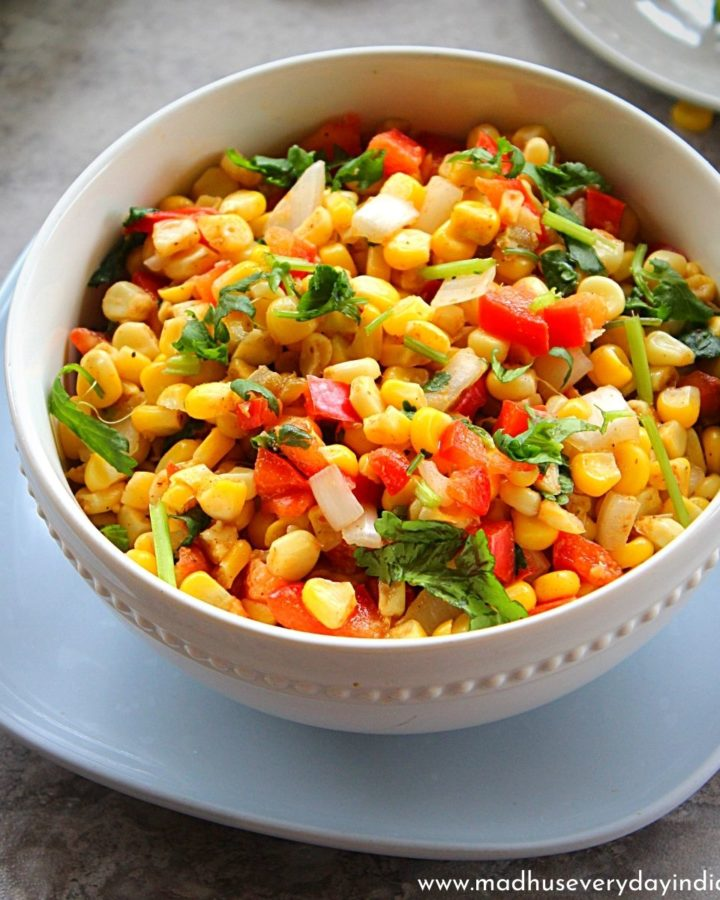 indian corn salad served in a large white bowl.