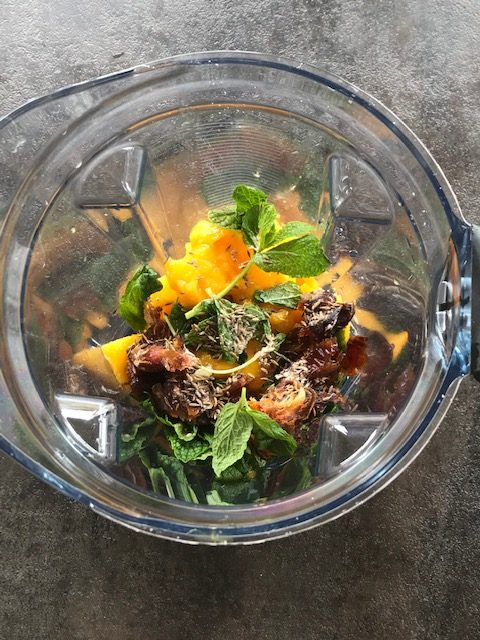 mango, mint, dates and water added to a vitamix blender
