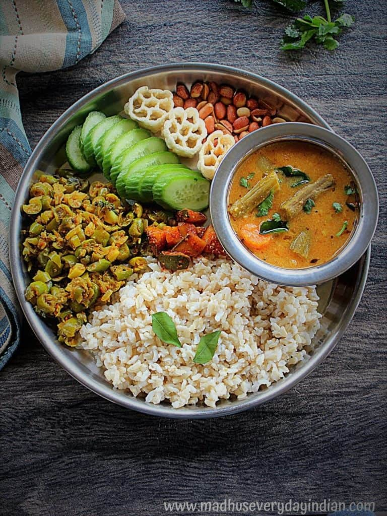 Sambar served with brown rice, tindora Fry, mango pickle , cucumber, fryums and peanuts.