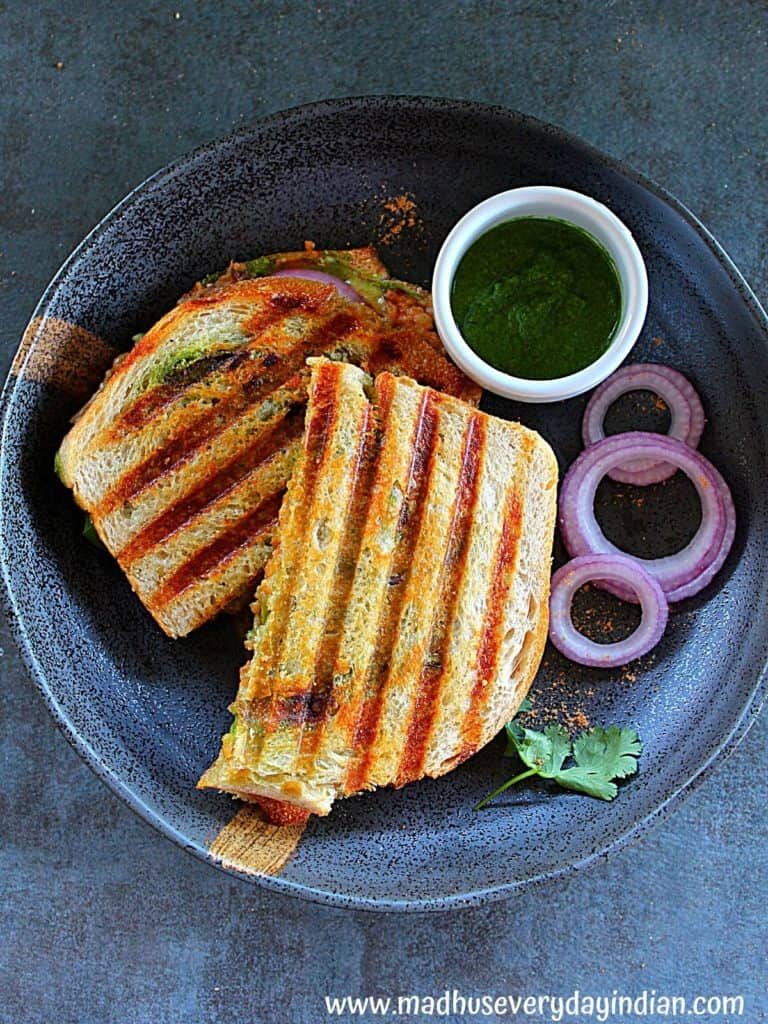 two samosa grilled cheese served with green chutney and slices red onion