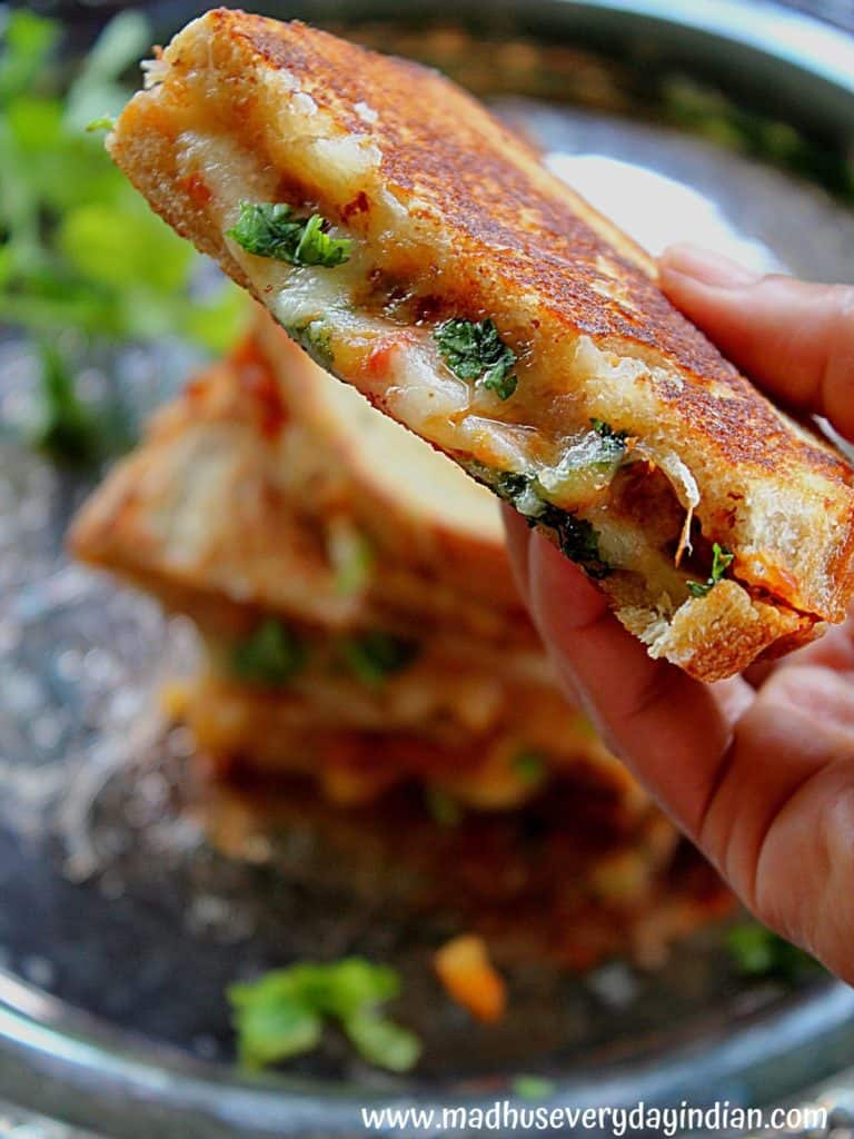 tomato chutney grilled cheese held in the hand