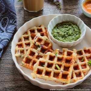 4 dosa waffles served with green chutney