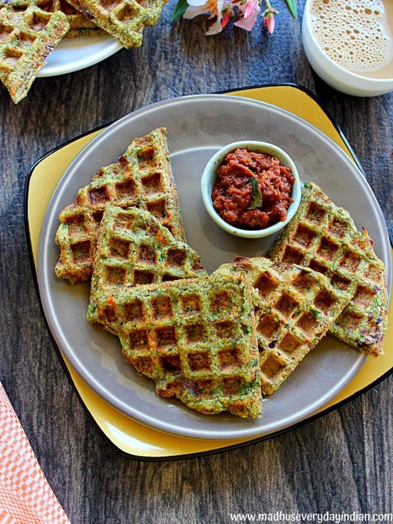 green moong dal waffles served ina  plate with onion chutney and coffee