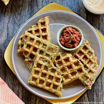 5 green moong dal waffles served with onion chutney