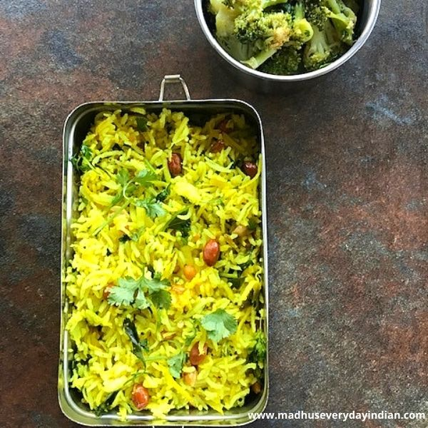 mango rice served in a steel box with sauteed broccoli
