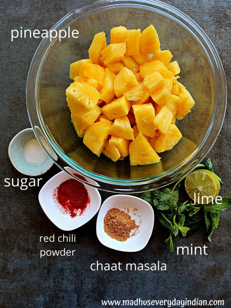 cut pineapple, mint, lime and spices in the picture