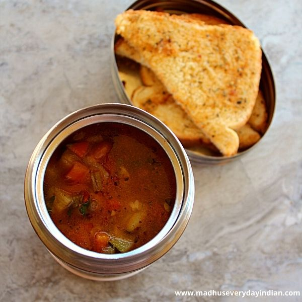 vegetable pinto beans soup in thermos with garlic bread