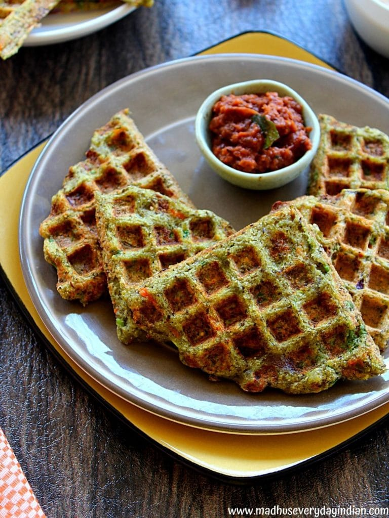 green moong dal waffles served with onion chutney