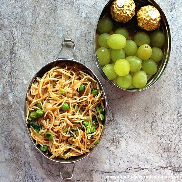 vermicelli pulao, grapes and ferro Rocher served in a steel box