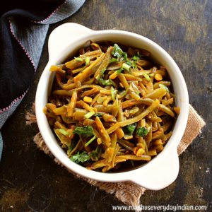 frozen french cut green beans fry indian style served in a white bowl