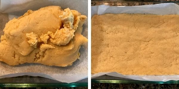 ricotta cheese burfi poured in a glass pan
