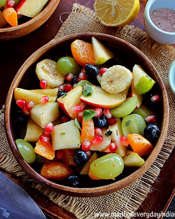 fruit chaat served in a wooden bowl